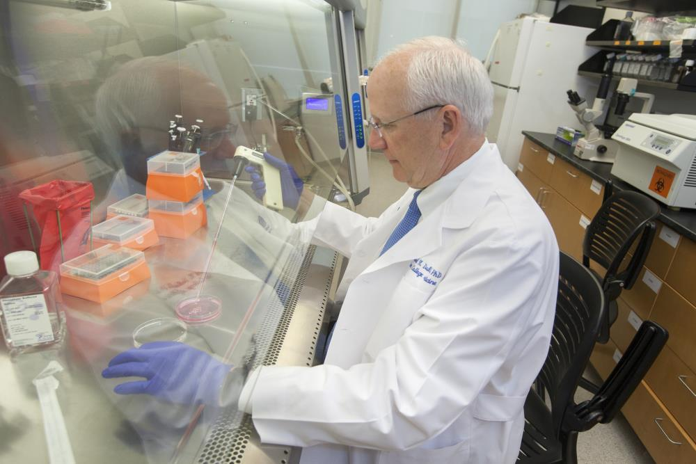Dr. Raymond Dubois, noted cancer researcher and dean of the MUSC College of Medicine, in the laboratory.