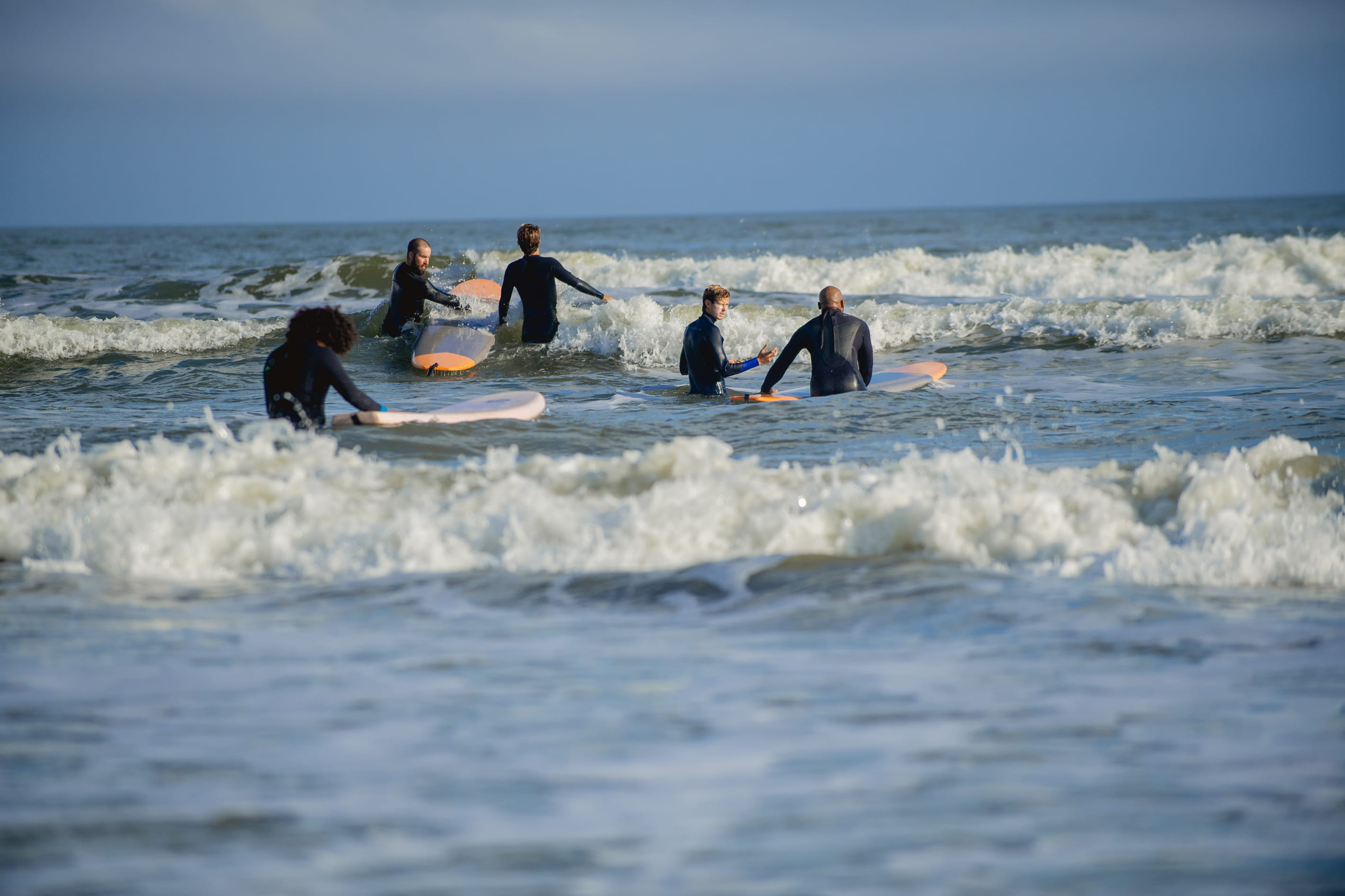 Veterans learns the art of surfing with help from Warrior Surf Foundation instructors. Photo courtesy of Warrior Surf.