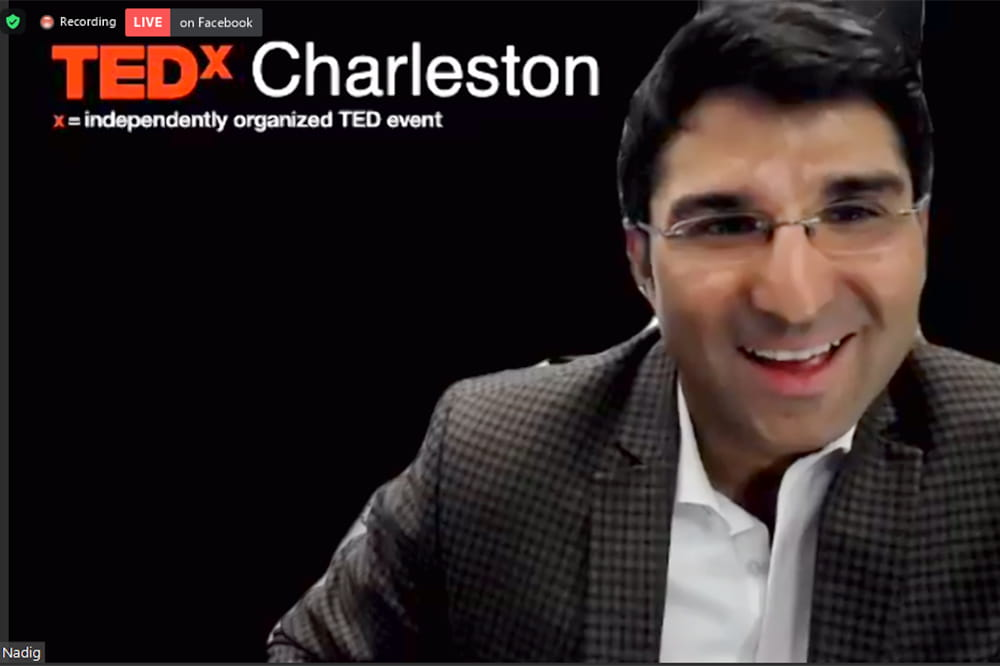 A screenshot of Satish Nadig in the virtual TEDx presentation