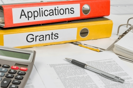binders labeled application and grants